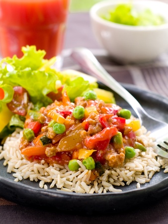 chicken rice: Delicious rice with vegetables  and parsley. Selective focus Stock Photo