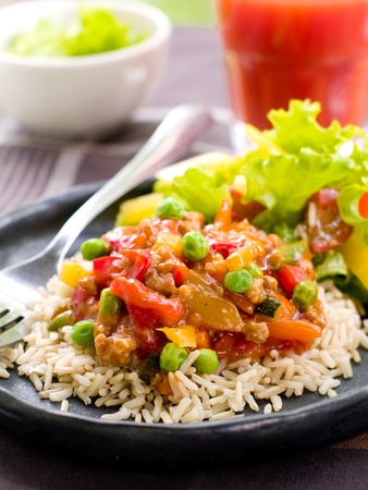 Delicious rice with vegetables  and parsley. Selective focus Stock Photo