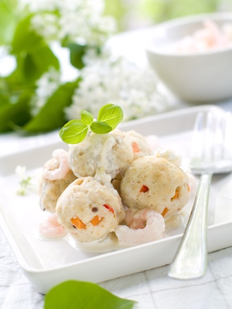 Minced meat balls with vegetables and shrimp sauce photo