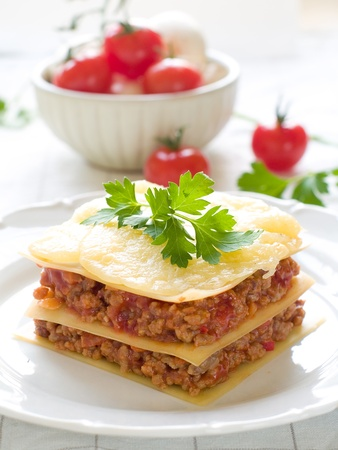 Lasagne with meat, tomato and cheese. Selective focus photo