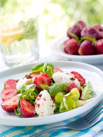 Fresh salad with mascarpone and strawberry. Selective focus photo
