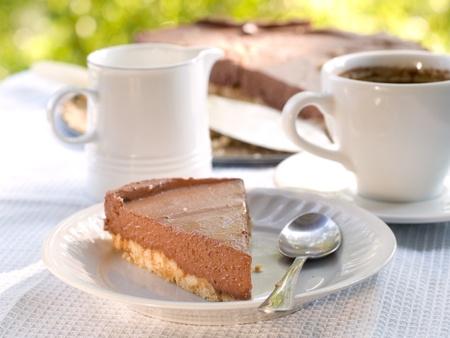 Chocolate cheesecake with coffee.  Selective focus photo