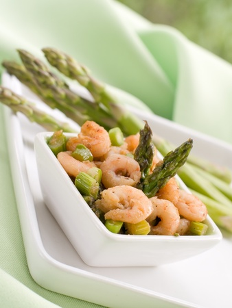 Appetizer with baked shrimp and asparagus. Selective focus, shallow depth photo