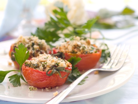 crumble: Stuffed tomato with crumble. Shallow doff, selective focus