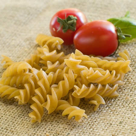 fusilli: Pasta ingredients; fresh fusilli, tomato, parsleySelective focus