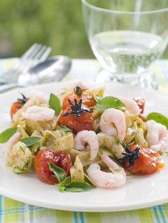 Tagliatelle with shrimp, tomato and pesto. Selective focus photo