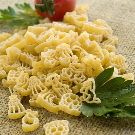 Pasta ingredients; fresh children makaroni, tomato, parsleySelective focus Stock Photo - 10318630