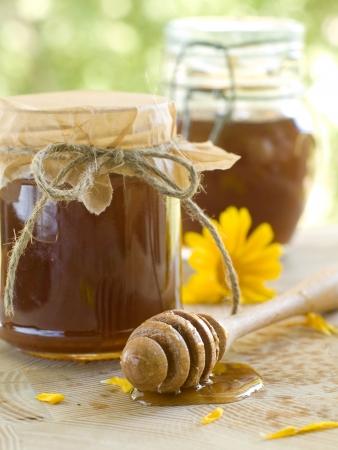 Flower honey in glass jar. Selective focus Stock Photo - 10418550