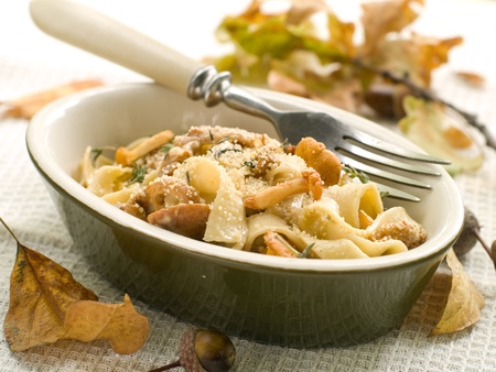 Tagliatelle with chanterelle, parmesan and thyme. Selective focus photo