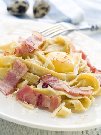 Tagliatelle pasta with bacon and yolk. Selective focus  photo