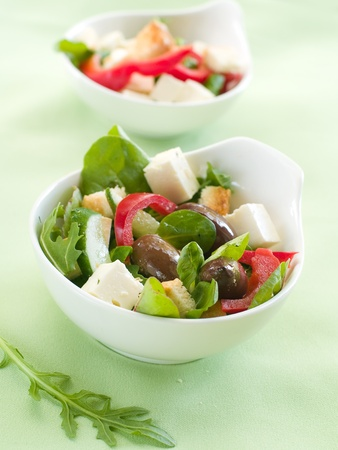 Fresh vegetable salad with calamata olives, crouton and cheese. Selective focus photo
