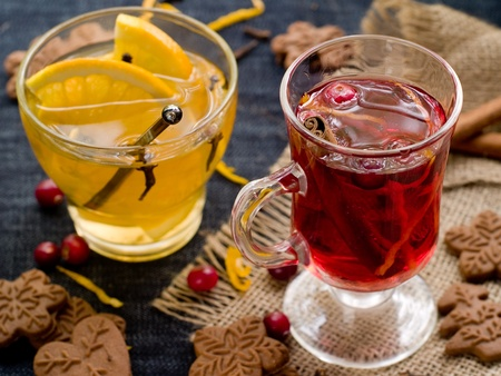 Hot drinks with cranberries and orange. Selective focus photo