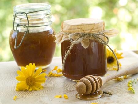 Flower honey in glass jar. Selective focus photo
