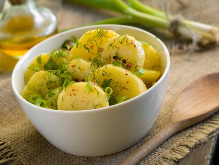 salad dressing: Potato salad with parsley, dill and olive oil. Selective focus