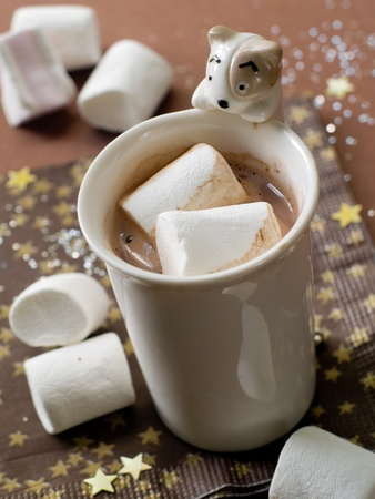Hot chocolate with marshmellows in a christmas theme. Selective focus