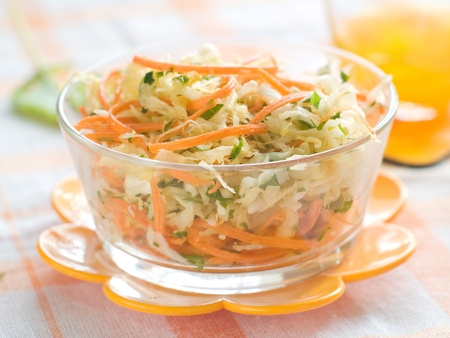 A bowl of cabbage and carrot salad. Selective focus