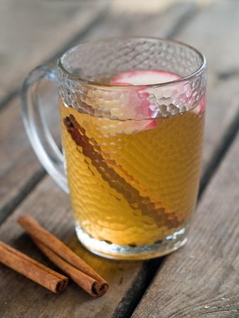 apple and cinnamon: Hot drink with  cinnamon. Selective focus