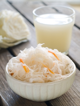 Sauerkraut with carrot in bowl, selective focus Stock Photo