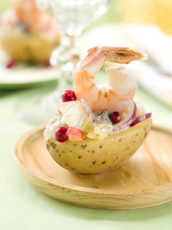 Potato with salad and shrimp, selective focus photo