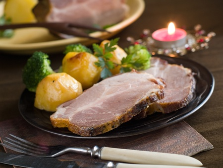 Roasted meat with broccoli and potatoes. Selective focus photo