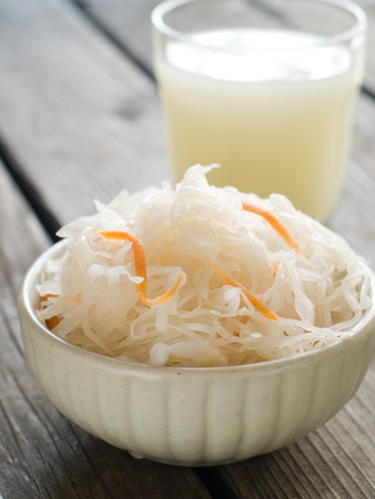Sauerkraut with carrot in bowl, selective focus photo