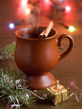 Hot mulled wine in cup, selective focus photo