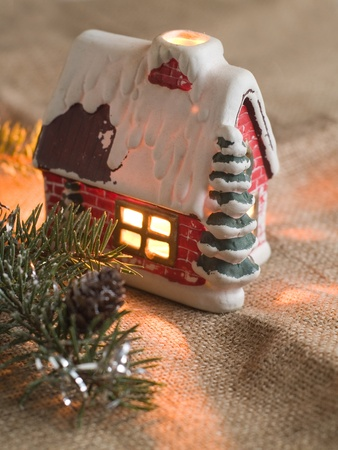 Christmas candle house with light, selective focus  photo
