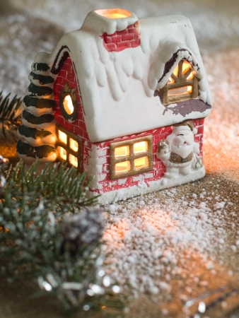 Christmas candle house with light, selective focus Stock Photo - 11307269
