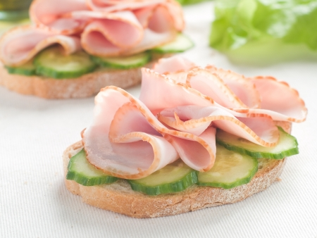 toasted: Sandwich with cucumber and ham, selective focus