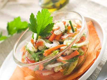 A bowl of fresh vegetables salad, selective focus
