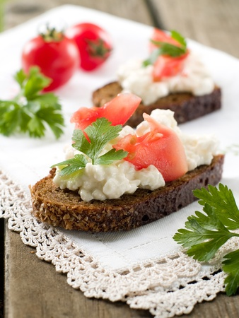 cottage cheese: Bread with cittage cheese and tomatoes, selective focus Stock Photo