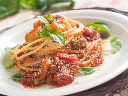 Spaghetti with meat and vegetable sauce, selective focus