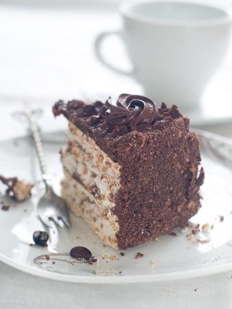 Chocolate cake with tea cups, selective focus photo