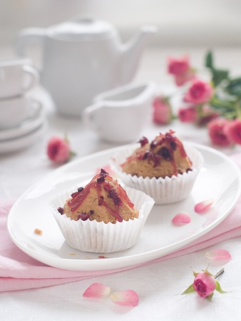 Little cupcakes with coffee cups, selective focus photo