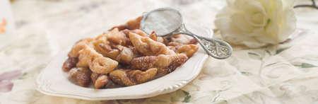 crostoli: Crostoli (deep fired Italian pastries with icing sugar)