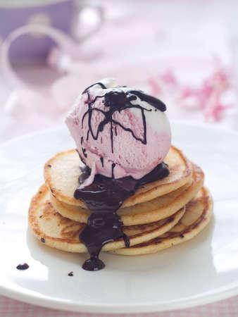 Pancake with ice cream and chocolate sauce, selective focus