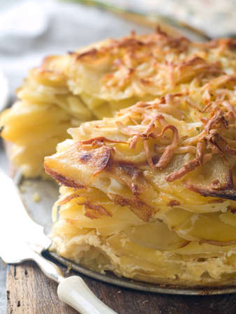 Potato gratin with cheese on plate, selective focus