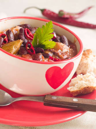 Vegetable chili in bowl, selective focus photo