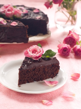 torte: Chocolate cake with sugar rose, selective focus Stock Photo