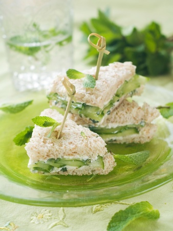 Healthy sandwich with fresh cheese, cucumber and mint for breakfast, selective focus  Stock Photo
