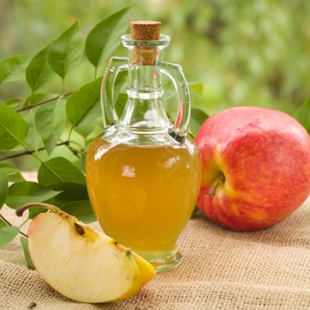 cider: Apple cider vinegar in glass bottle, selective focus