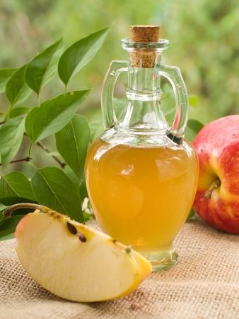 Apple cider vinegar in glass bottle, selective focus photo