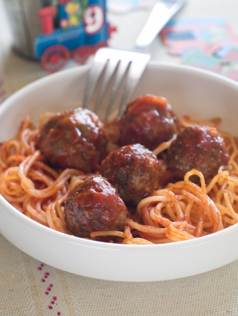 Meatballs with tomato sauce and spaghetti, selective focus. Shot for a story on homemade, organic, healthy baby foods.  photo