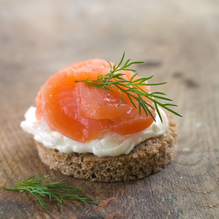 Canape with salmon and dill for party, selective focus
