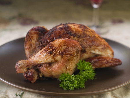 Baked whole chicken with parsley for dinner, selective fous