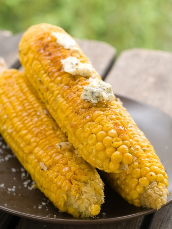 Grilled corn with butter, selective focus photo