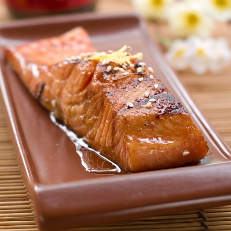 cooked meat: Grilled salmon fillet with sauce and sesame seeds, selective focus