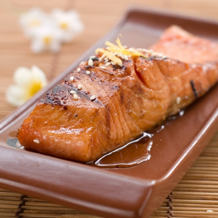 Grilled salmon fillet with sauce and sesame seeds, selective focus