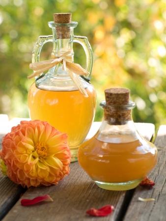 Apple cider vinegar in glass bottle, selective focus