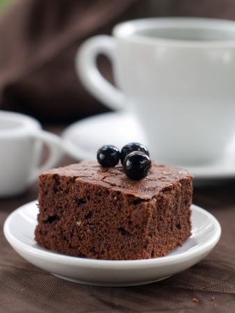 Chocolate brownie with coffee, selective focus photo